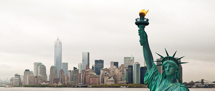 The Statue of Liberty in front of the skyline of New York City