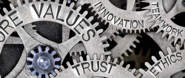 Gears with words like ethics, trust, and values inscribed