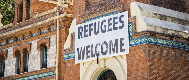 "Banner saying ""Refugees Welcome"" hangs above the door of a church"