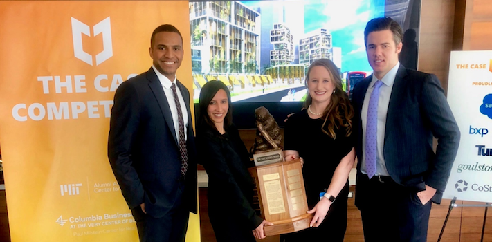 Real Estate students pose with trophy after winning CASE competition