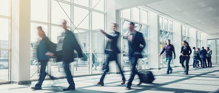 Business people walking through an airport