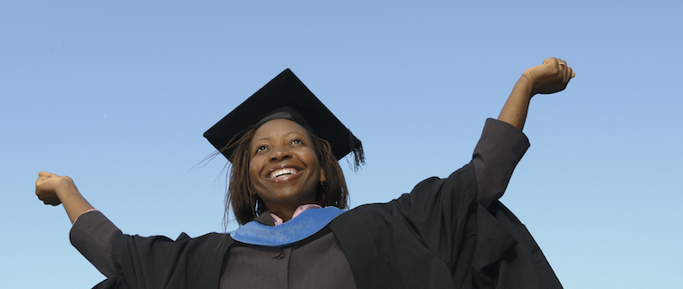 A woman showing her joy at graduating