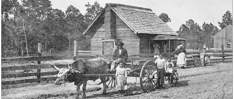 family of farmers in their wagon