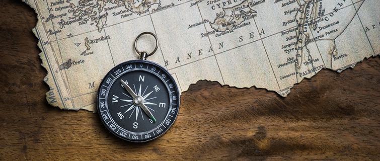 Compass on an old tattered map