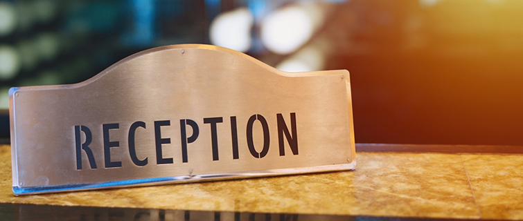 A sign for the reception desk at a hotel