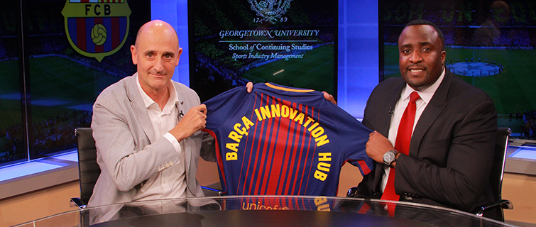 Daniel G. Kelly II, Ph.D., Faculty Director, Master's in Sports Industry Management and Jordi Moix, Member of the Board, FC Barcelona show off the new FC Barcelona jersey.