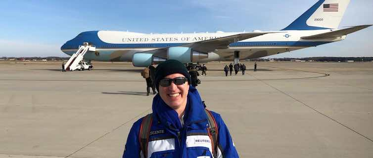reporter in front of Air Force One