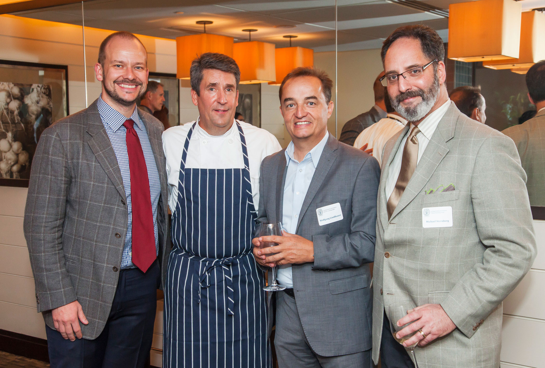 Executive Director Gray Shealy, and panelists, James Beard Award-Winning Chef of Vidalia Jeffrey Buben, Chief Discipline Leader of Global Operations for Marriott International Wolfgang Lindlbauer, and Star Restaurant Group CEO Michael Sternberg prepare for a discussion on brand evolution in the food and beverage industry.