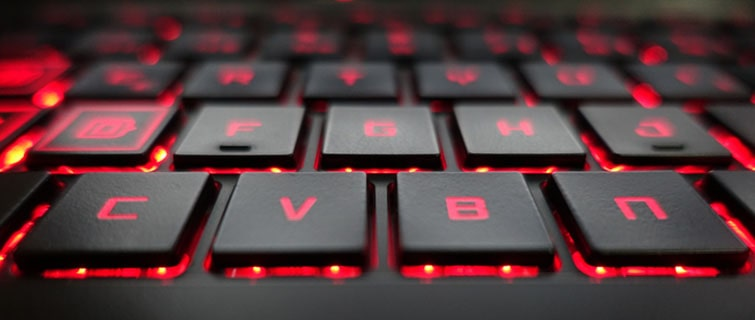 laptop keyboard with red colored lit up keys