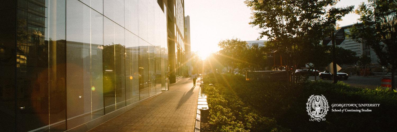 SCS Exterior at Sunset-Georgetown University Crest
