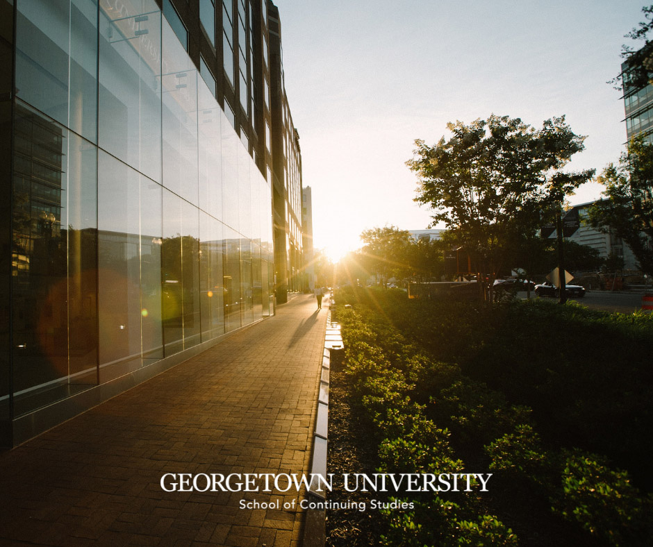 SCS Exterior at Sunset-Georgetown University Logotype