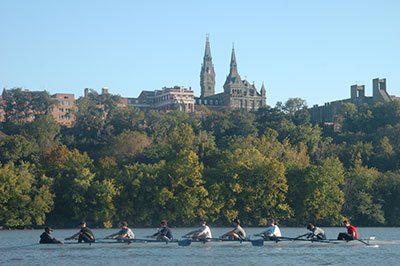 Rowing team on Potomoac river with Georgetown in background