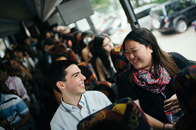 Two students chatting during bus ride