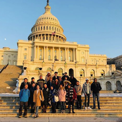 Students posing in front of the U.S. Capital.